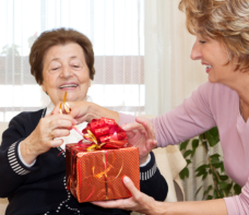 helping elder female opening gift
